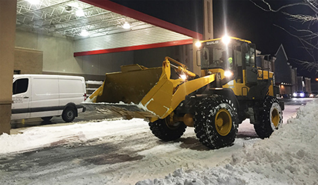 Stasi Brothers uses SDLG front loader for snow removal