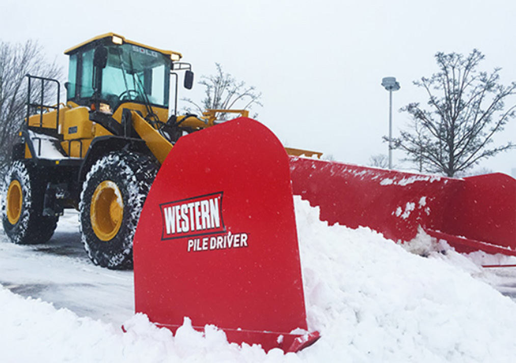 Stasi Brothers uses SDLG front loader with pile driver for snow removal